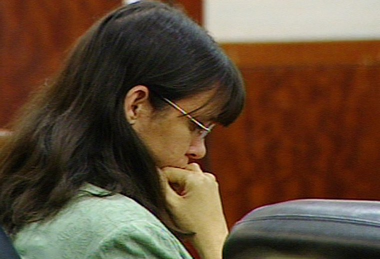 Andrea Yates listens to opening arguments in her second murder trial in Houston, Texas