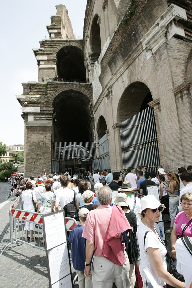 Tourists wait for security check as they line up outside Rome's Colosseum on June 19. Inhabitants of the Dark Ages feared that if the Colosseum collapsed, so would Rome and the whole world. So far, the symbol of the Eternal City has made it through 2,000 years.