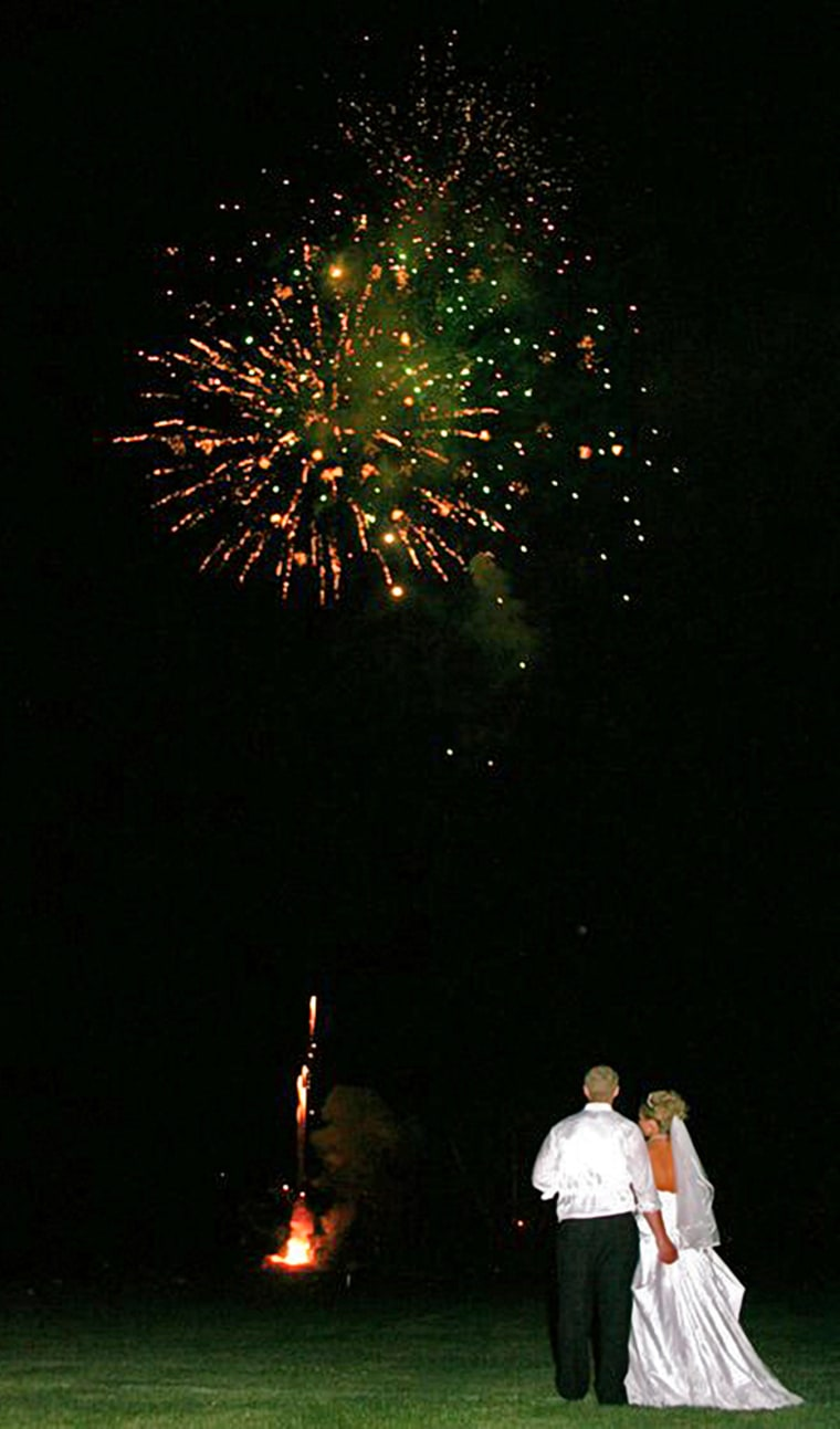 In this family photo, fireworks burst at the June 17 wedding celebration of Jason Klismith and Beth Jenkin in Stevens Point, Wis.