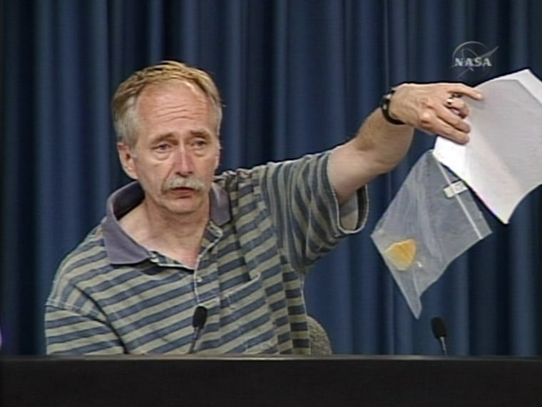 Bill Gerstenmaier, NASA associate administrator for space operations, holds up the piece of foam insulationthatfell off Discovery's external fuel tank during a press conference Monday. NASA managers gave the go-ahead Monday night for a Fourth of July space shuttle launch.