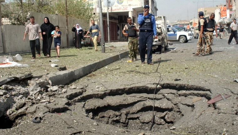 Iraqi police and army secure the area Monday after Monday's bomb attack in the northern city of Mosul.