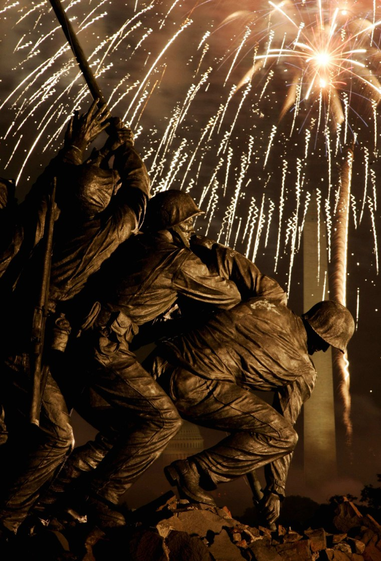 Fireworks light the sky behind the Iwo Jima memorial over Washington D.C.