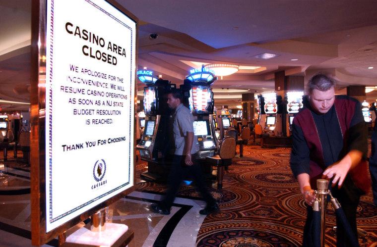 A casino worker closes off the casino floor at Caesar's Atlantic City casino on Wednesday.