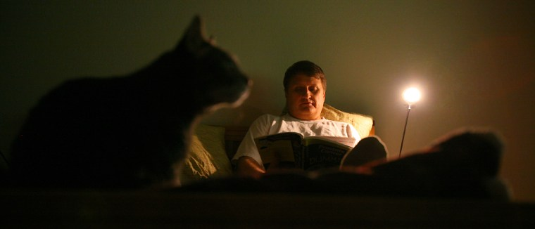 Mike Stuckey spent many hoursin his bedroom researching prostate-cancer treatment options. His cat, Girl, frequently kept him company.