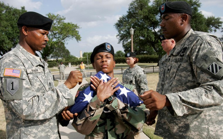 Willette Combs (center) takes the flag Sgt. Amin Brima . Willette Combs. Blandon Green