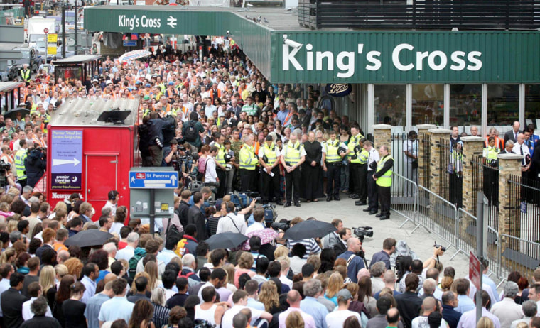 A two-minute silence is observed at King's Cross station in Londonon Friday. Four explosion from suicide bombers one year ago killed 52 people.