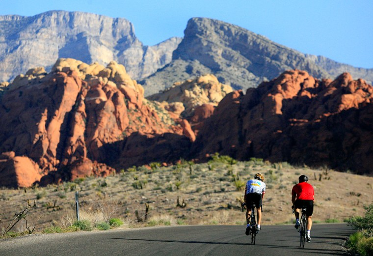 Two cyclists ride along the 13-mile-long scenic drive at Red Rock Canyon National Conservation Area in Nevada, May 6, 2006.