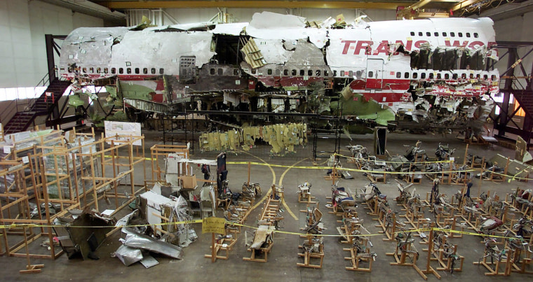 The seats and other wreckage of TWA Flight 800 sits in a hangar in Calverton, N.Y., in a 2001 file photo. Investigators eventually recovered 98 percent of the wreckage of the airliner that crashed off the Long Island coast shortly after takeoff on July 17, 1996.