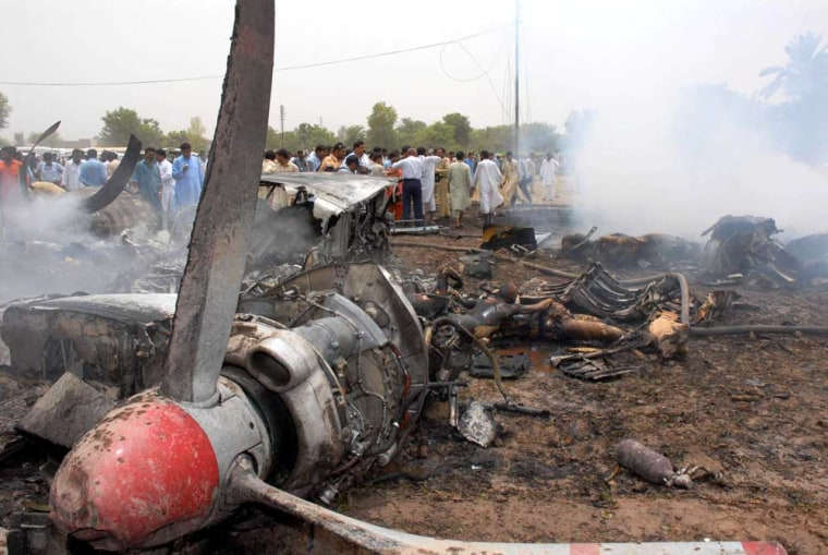 People gather near the wreckage of a Pakistani twin-engine passenger plane that crashed in Multan, Pakistan, onMonday. The 45 people on board were all killed in the crash.