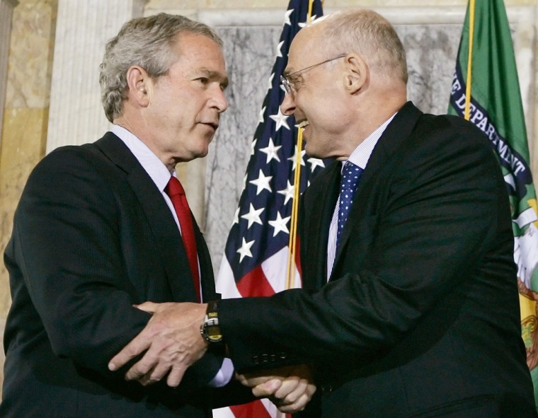 Newly sworn in US Treasury Secretary Henry Paulson is congratulated by President George W Bush during a ceremony in Washington