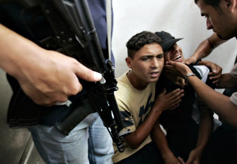 Relatives of two Islamic Jihad militants killed in an Israeli airstrike mourn at the militants' funeral services Monday.