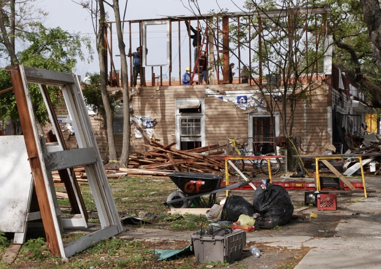 Work crews deconstruct a house damaged by Hurricane Katrina in the Lower Ninth Ward in New Orleans on March 28.