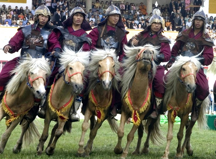 Mongolian horsemen in traditional costumes perform during the Naadam opening ceremony in Ulan Bator, Mongolia, on Tuesday.