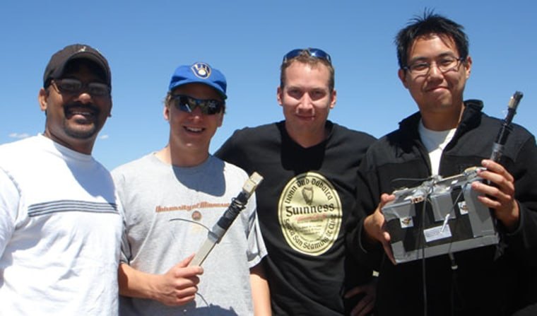 University of Minnesota students proudly display their Minnesatprojectafterits high-altitude balloon flight. This team project evaluated use of Global Positioning System satellites to determine attitude of their payload package.