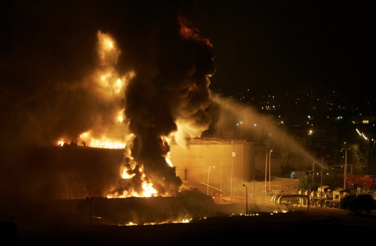 Fire rises from fuel tanks at Beirut international airport after being attacked by Israeli aircrafts