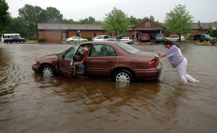 This roadin Newburgh, Ind., was among the areas that flooded Wednesday in the northern part of the state.