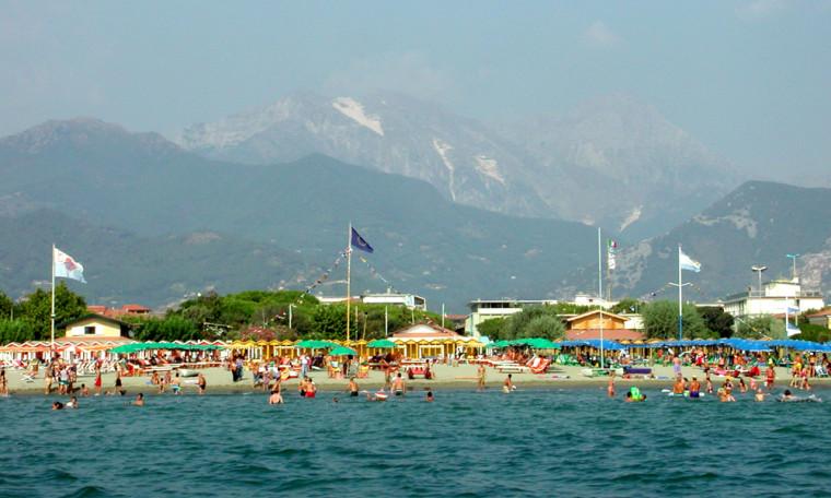 Vacationers bathe and lounge at the beach in Forte dei Marmi, Italy.