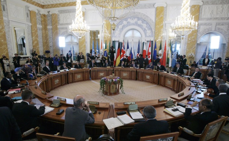 Leaders of the G-8 are joined by other invited world leadersat a meeting during the summit in St. Petersburg, Russia, on Monday.