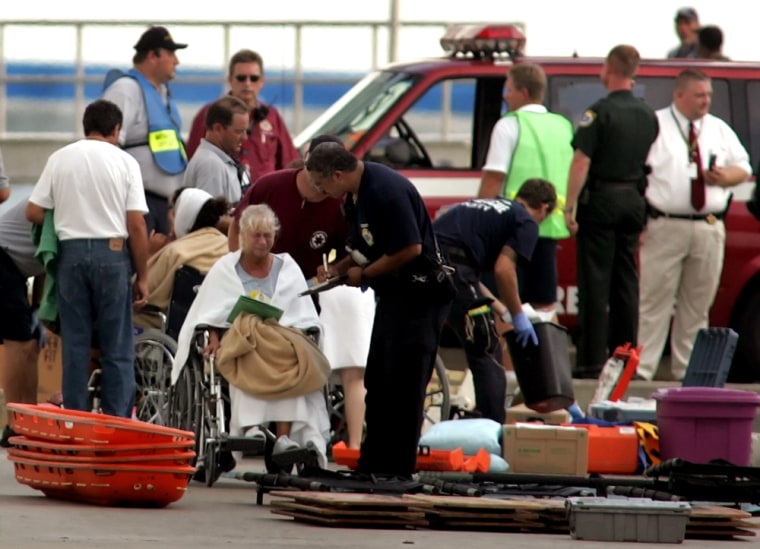 Injured passengers are attended to after being evacuated from the cruise ship Crown Princess in Cape Canaveral