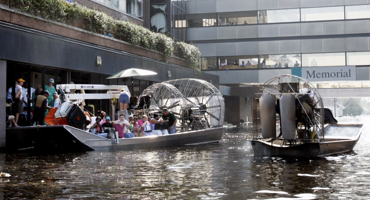 An airboat pulls up to the Memorial Medical Center in New Orleans on Aug. 31, 2005.