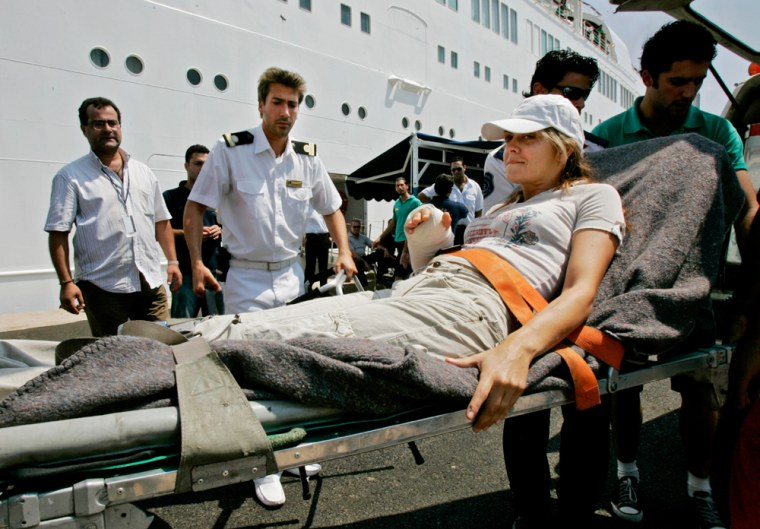 An American woman is stretchered onto the Orient Queen cruise ship in Beirut on Wednesday. The boat was chartered by the U.S. government to evacuate Americans trapped in Lebanon by the ongoing Israel-Hezbollah conflict.