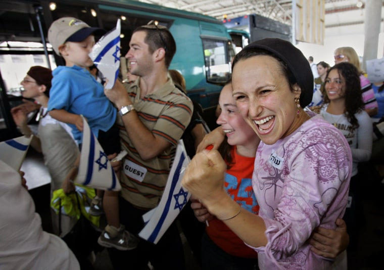 Nearly 230 immigrants from the U.S. and Canada react as they arrive at Ben Gurion Airport near Tel Aviv, Israel, Thursday.
