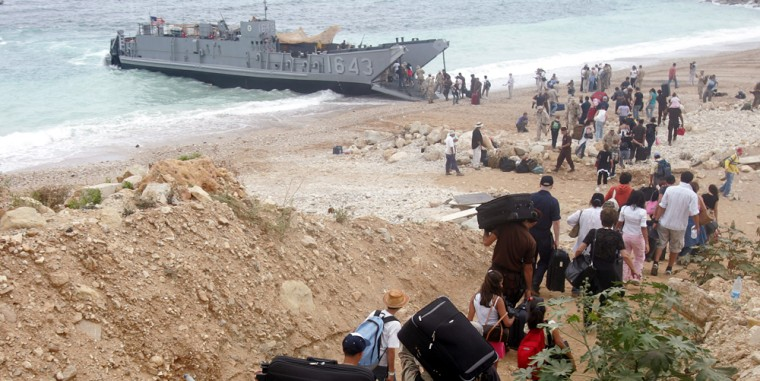 Americans haul luggagetowards a U.S.landing craftat a beach in Beirut, Lebanon, on Friday. The U.S. said it was prepared to evacuate about 5,000 Americans as the international exodus from besieged Lebanon reached a peak.