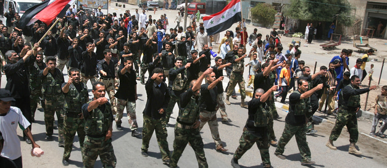 Members of the radical Shiite cleric Muqtada al-Sadr's Mahdi Army march in a protest, denouncing the Israeli attacks on Lebanon after prayers onFriday.
