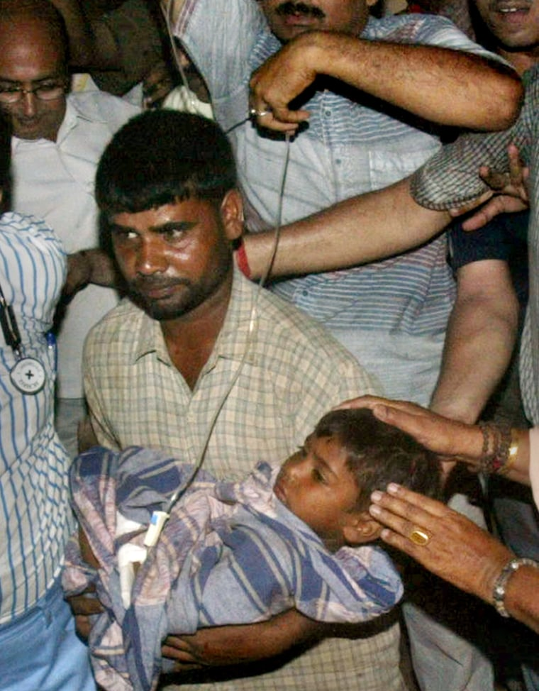Prince is carried by his father Sunday after he was rescued from an 60-foot-deep hole at Aldeharhi, in the northern Indian state of Haryana. India was gripped by the dramatic rescue with some channels suspending regular coverage to devote nearly all their air time to the rescue effort.