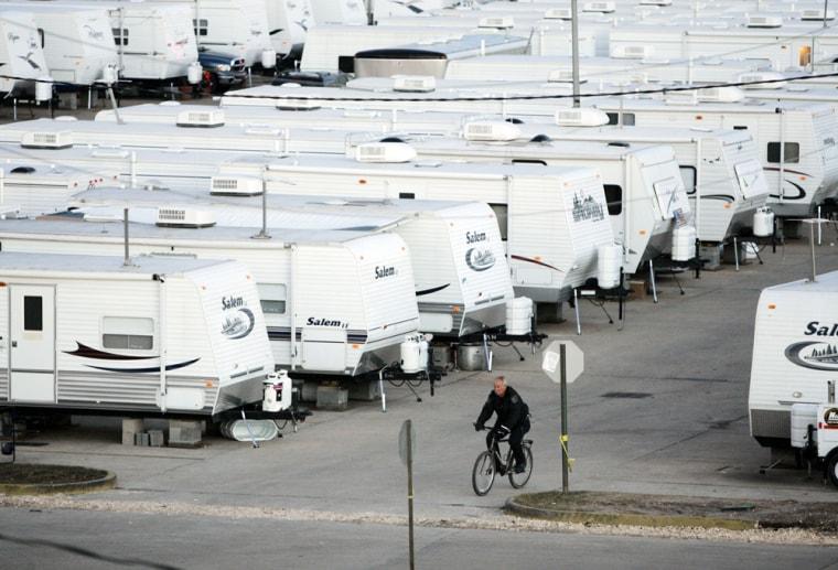 A Sheriff Department deputy patrols a FEMA trailer park in St. Bernard Parish, La.