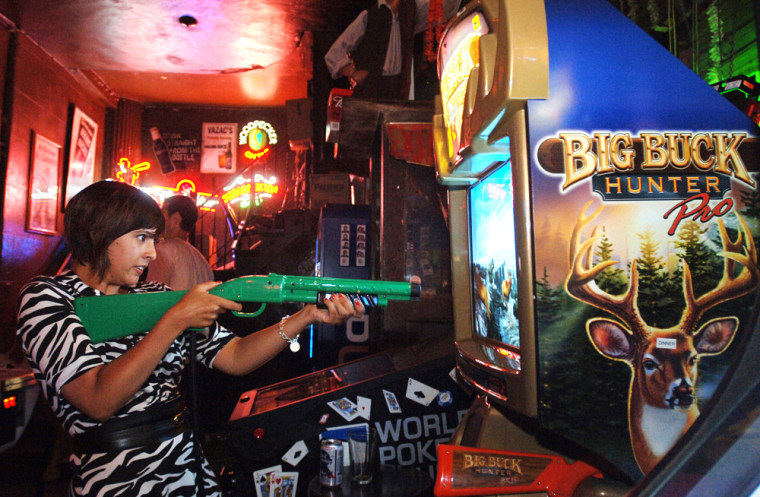 Alexandra Broseus plays the latest version of Big Buck Hunter at 7B, a bar on Manhattan's Lower East Side. The simulated hunting game is currently among the nation's most popular arcade games.