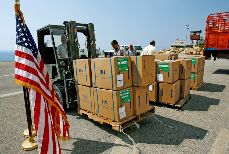 Workers move boxes of aid in the U.S. embassy in Beirut on Tuesday.