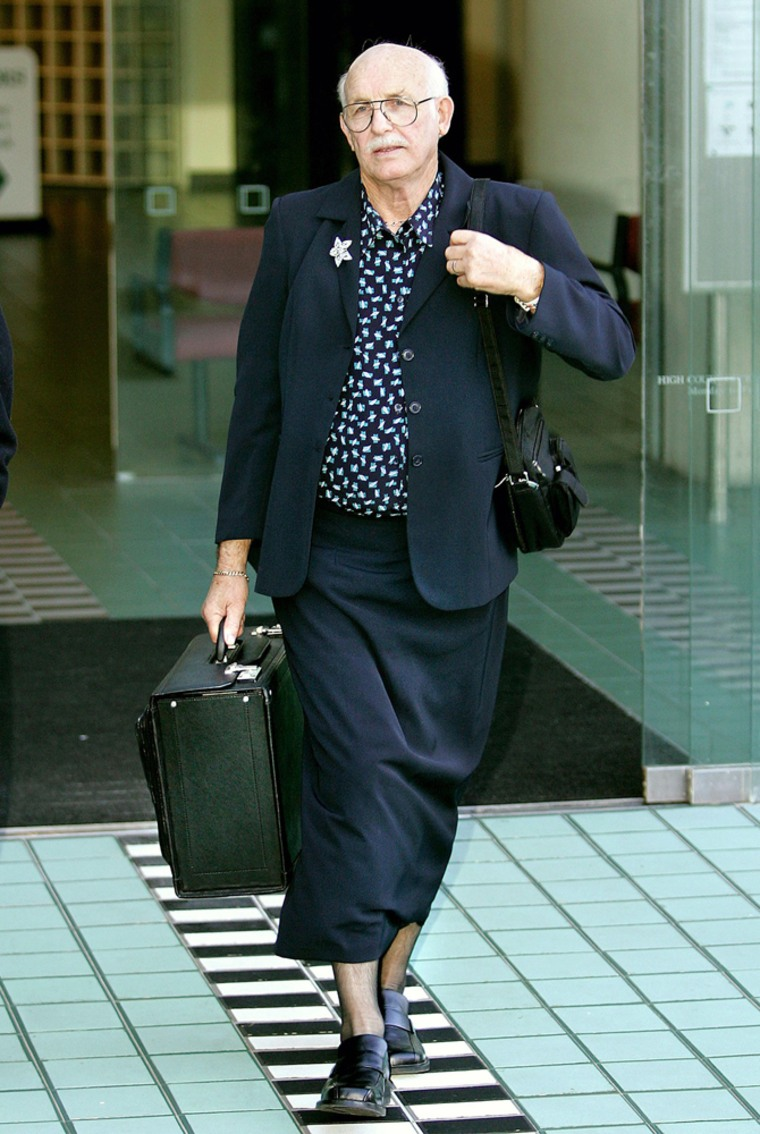 New Zealand lawyer Moodie walks out of high court in Wellington wearing women's stockings and skirt