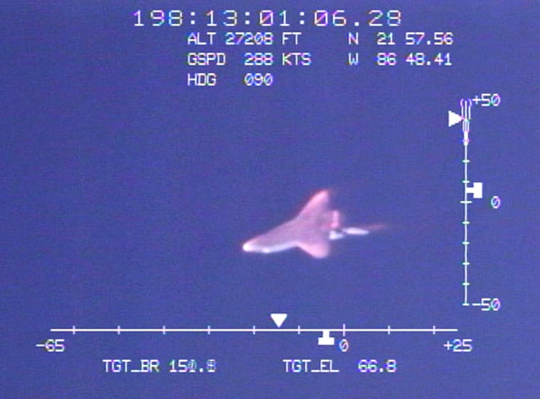 To cameras tuned to the visible range of the light spectrum, Discovery's STS-121 reentry July 17 looked like this just before its successful landing.