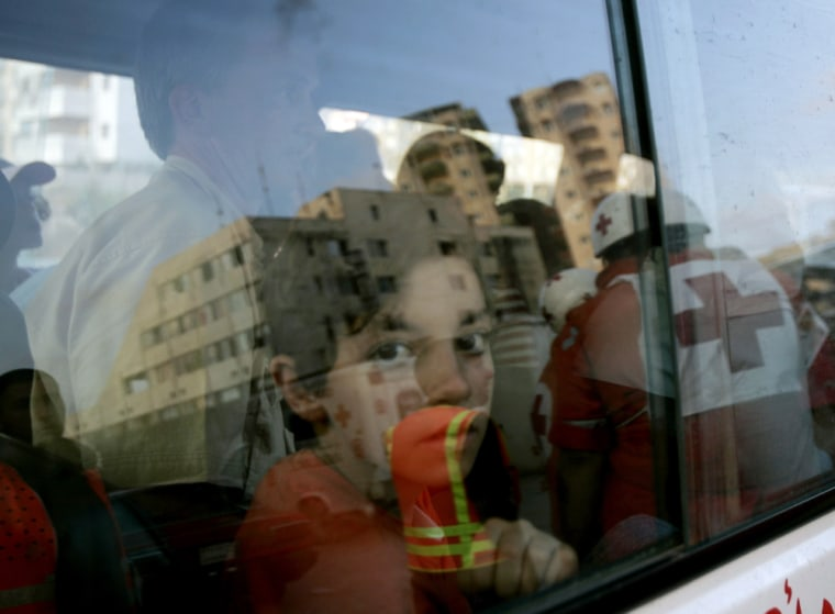 A Red Cross ambulance evacuates civilians from the the Najem Hospital in Tyre, Lebanon, on Tuesday after the facility was hit byIsraelimissiles.