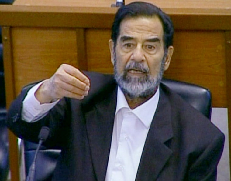 Saddam Hussein appears in a Baghdad courtroom on Wednesday.