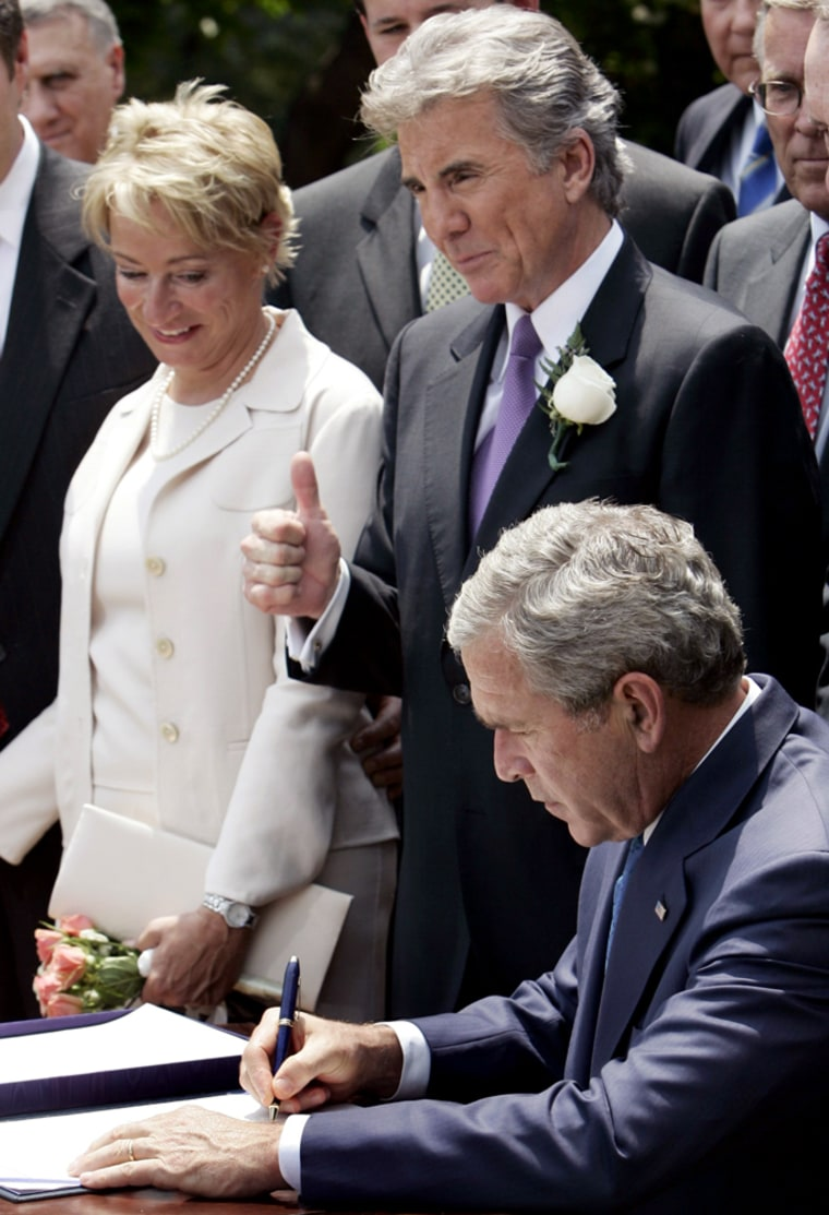 US President George W Bush signs the Adam Walsh Child Protection and Safety Act at the White House in Washington