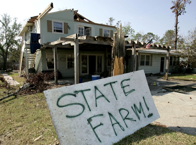 A Hurricane Katrina victim leaves no doubt that he would like a visit by the State Farm insurance adjuster in Gulfport, Miss., last year. State Farm said Wednesday it will stop writing homeowner polices in Mississippi as fights a number of Katrina-related lawsuits.