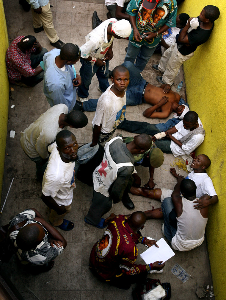 Supporters of presidential candidate Jean-Pierre Bemba wounded during clashes outside the Tata Raphael stadium in Kinshasa, Congoare treated inside the stadium Thursday during a rally for the Congolese Liberation Movement.