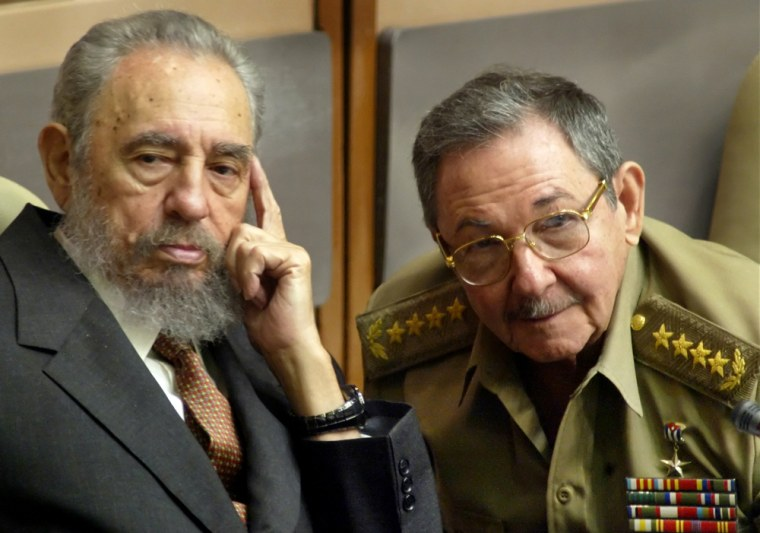 Cuban President Fidel Castro, left, and his brother Raul Castro, minister of defense, at aCuban Parliament session in Havana on July 1, 2004.