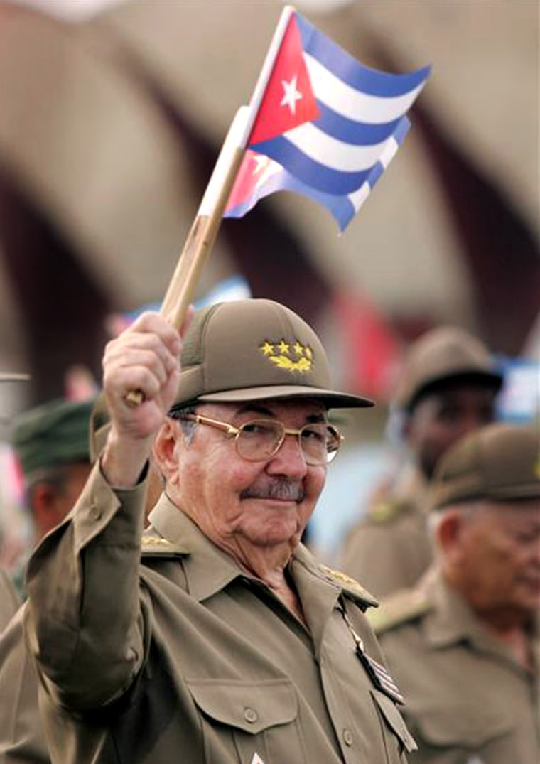 File photo of Cuba's Defense Minister Raul Castro marching with hundreds of thousands of Cubans past the U.S. diplomatic mission in Havana