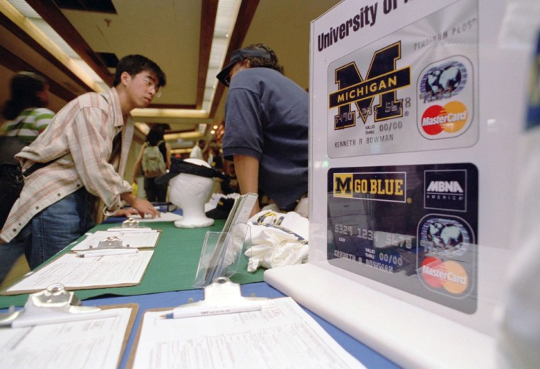 Geology grad student Xu Xiqiao, 21, applies for his first credit card on the campus of the University of Michigan where, like other campuses, the lure of easy credit is everywhere.