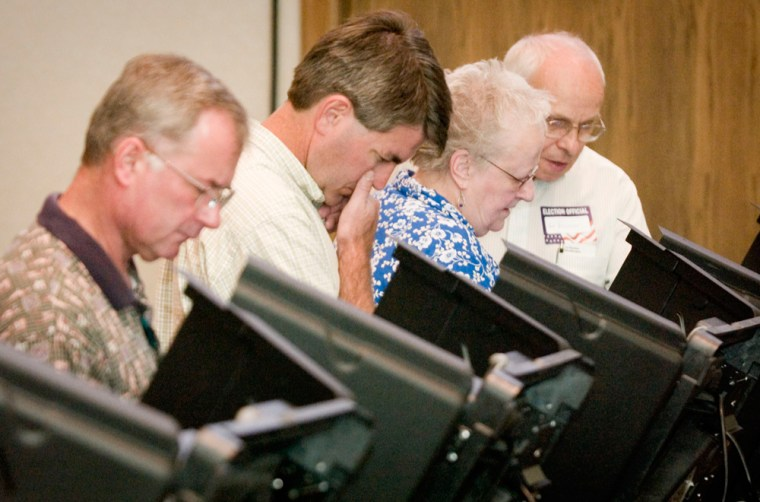 Voterscast electronic ballots Tuesdayat Grace Presbyterian Church in Wichita, Kan., during the primary election for Kansas political offices.