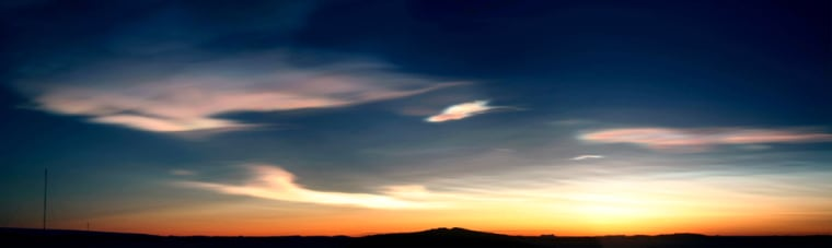 Rare mother-of-pearl coloured clouds caused by extreme weather conditions are seen above Australia's Mawson Station in Antarctica