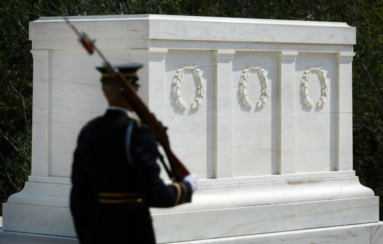 A guard stands watch over the Tomb of the Unknown Soldier at Arlington National Cemetery, on July 27. The Colorado quarry that supplied the original marble for thememorial in Arlington, Va., has found another block that may be suitable to replace the cracked monument.