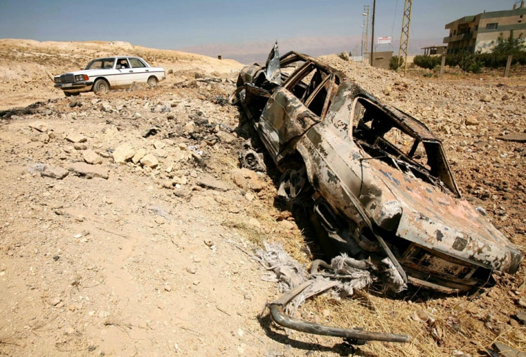A car lies on a road after an Israeli attack in the city of Baalbeck