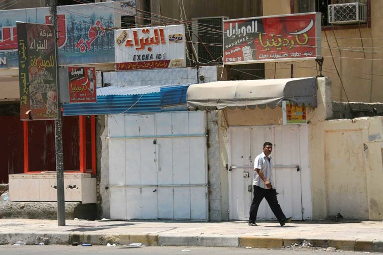An Iraqi man walks down a once popular but now empty market street, Tuesday, Aug. 1, 2006, in the Azamiyah district of Baghdad, Iraq. Sectarian violence and rising crime are transforming Baghdad's once bustling commercial hubs into deserted streets _ leaving the country's economy in tatters. Popular markets in neighborhoods such as the Sunni Azamiyah and Shiite Kazimiyah have all but disappeared.