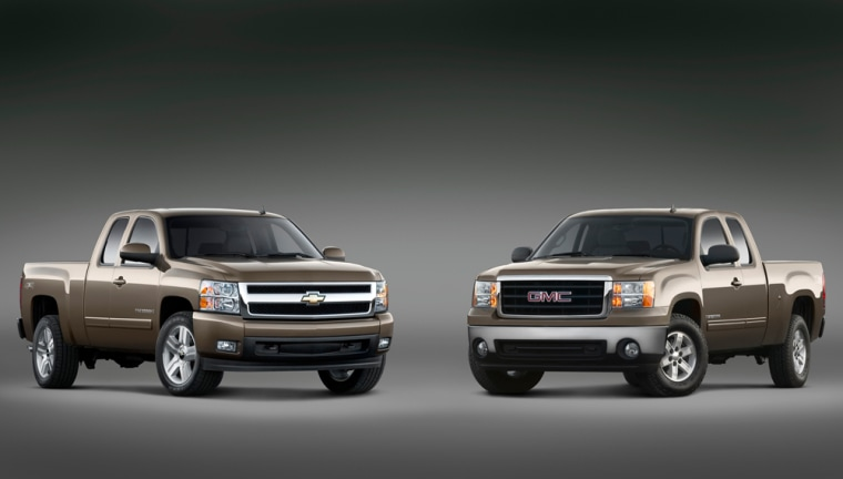General Motors unveiled two redesigned pickups Wednesday — the new Chevrolet Silverado (left) and the GMC Sierra (right).