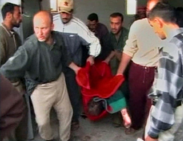Video grab shows body being carried in Haditha