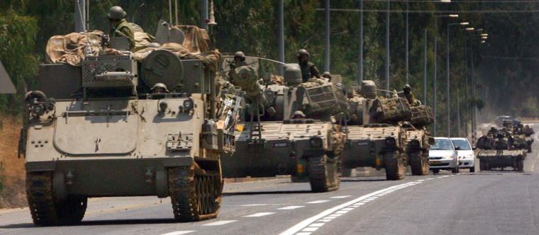 Israeli military vehicles move on road near northern city of Kiryat Shmona toward Israeli-Lebanese border